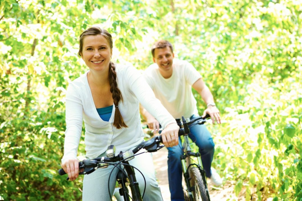 Healthy couple riding bikes